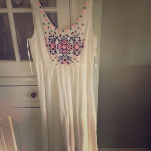 White dress with pink and navy blue embroidery